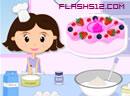小女孩做草莓蛋糕